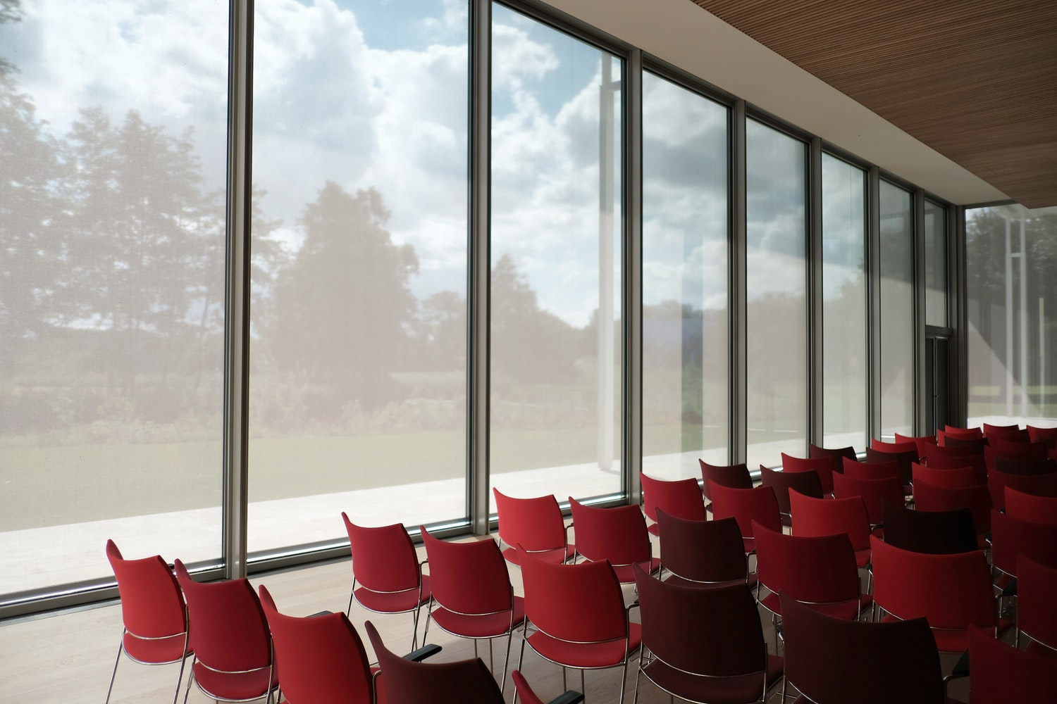 Classroom with large windows and an open sky