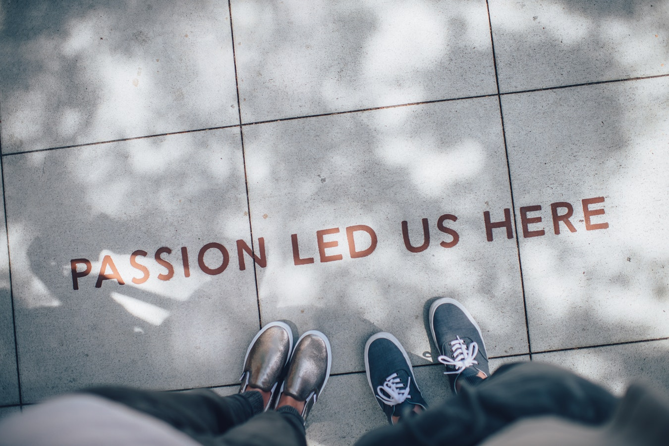 """Passion Led Us Here"" sidewalk inscription"