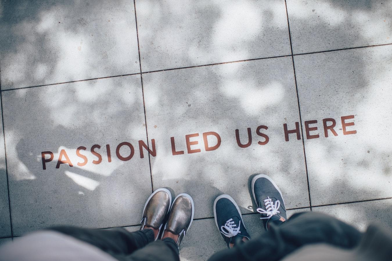 """Passion Led Us Here"" sidewalk inscription"